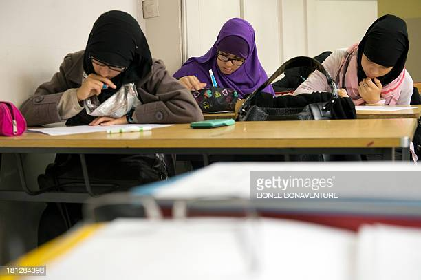 PLANTIVE Muslim faithful students are pictured in their classroom at the La Reussite muslim school on September 19 2013 in Aubervilliers outside...