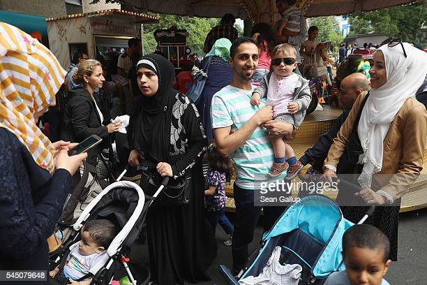 Muslim families attend a street fest in immigrantheavy Neukoelln district to celebrate the end of the Muslim month of Ramadan on July 5 2016 in...