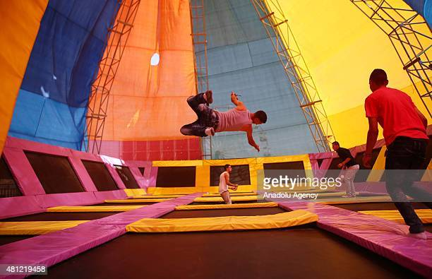 Muslim families fun at a fair on July 18 in Ramallah West Bank as they observe the Eid alFitr the threeday festival that follows the fasting month of...