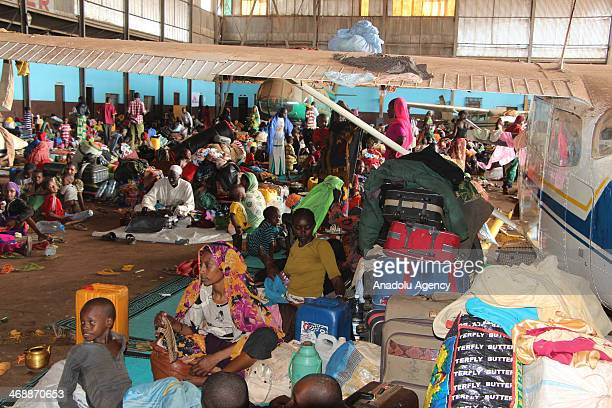 Muslim families seek shelter under an aeroplane at Bangui Airport in Central African Republic following the violence which makes ten of thousands of...