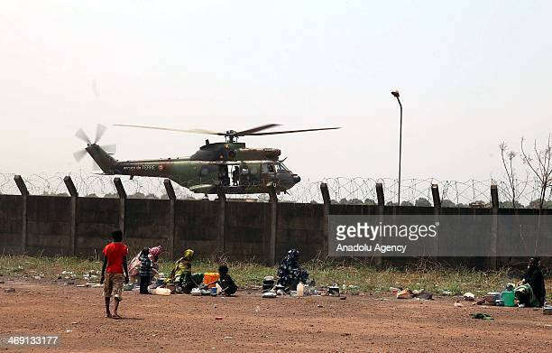 Muslim families sit at Bangui Airport in Central African Republic following the violence which makes ten of thousands of citizens displaced in the...