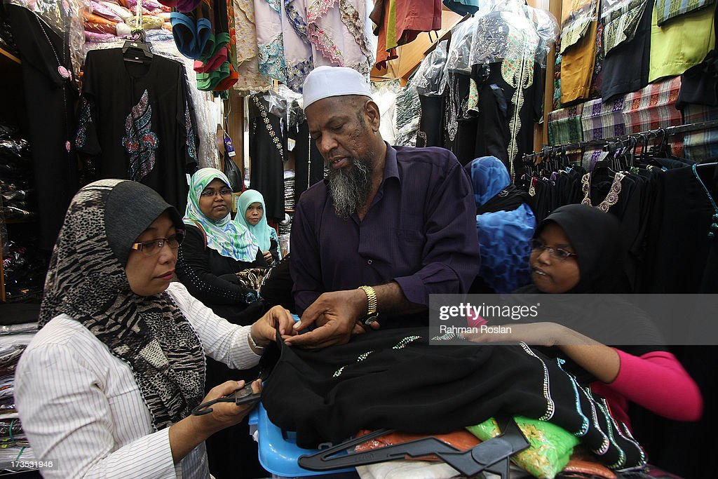 A Muslim family shops for clothes as millions of Muslims observe the holiday of Ramadhan on July 16, 2013 in Jalan Masjid India, Kuala Lumpur, Malaysia. During Ramadhan, Muslims refrain from consuming food, drinking liquids, smoking, swearing, and engaging in sexual relations from dawn till sunset.