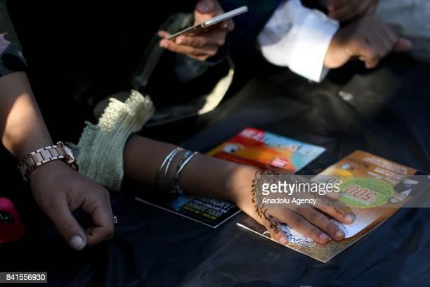 Muslim girl gets a henna tattoo after the Eid Al Adha prayer in Bensonhurst Park in Brooklyn borough of New York United States on September 01 2017