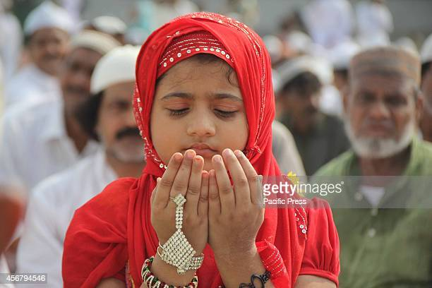 Muslim girl offers prayer on the occasion of Eid alAdha Festival at Eidgah in Allahabad Eid alAdha is a religious festival celebrated by Muslims...