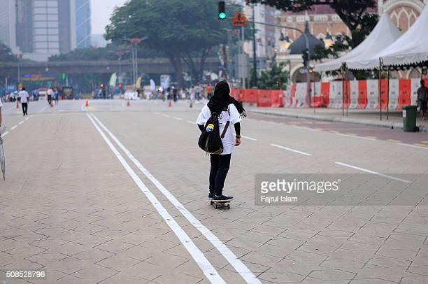 Muslim Girl Playing Skateboard