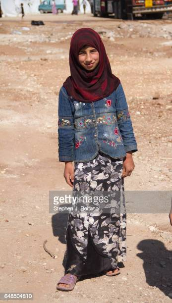 A'ZAZ ALEPPO SYRIA A muslim girl plays at the border with Turkey in A'zaz Syria