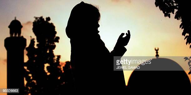 A Muslim girl prays at the MCC mosque during the last Friday of the Muslim's holy fasting month of Ramadan in Silver Spring Maryland on September 18...