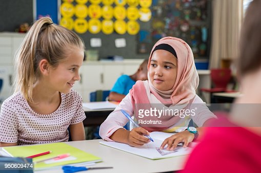 Muslim girl with her classmate : Stock Photo