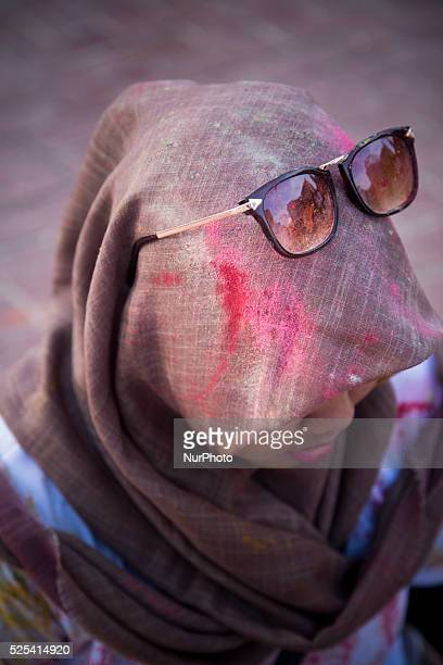A muslim girl with her hijab quotcoloredquot Holi color festival that was held in East Park Bung Karno Sport Center held for young people to have fun...