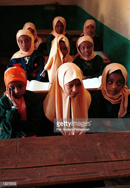 Muslim girls attend class at Sheikh Abubakar School April 11 2001 in Harar in eastern Ethiopia Villagers in the Muslim area have started a campaign...