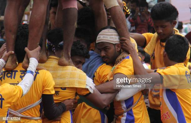 Muslim Govinda group forms the base of human pyramid to break Dahi Handi on the occasion of Janmashtami at Borivali on August 15 2017 in Mumbai India...