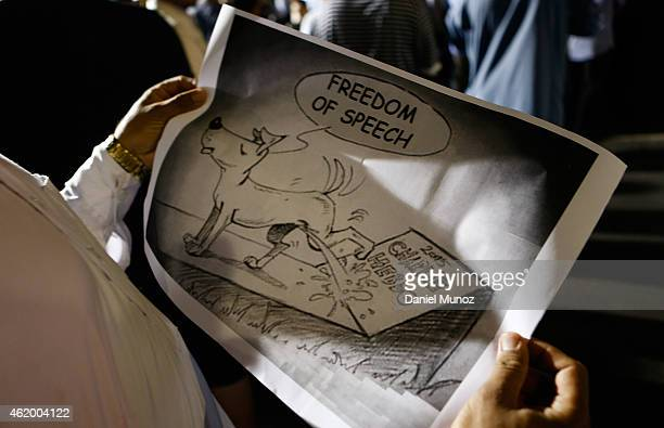 Muslim holds a cartoon during a rally to show their support for the Prophet Muhammad in the suburb of Lakemba on January 23 2015 in Sydney Australia...