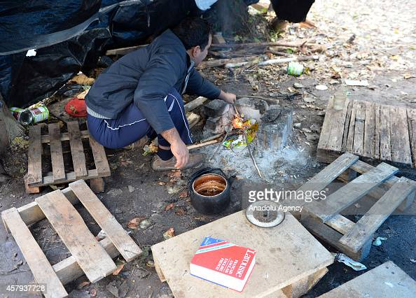 Muslim immigrants who abstain from eating the food distributed by French aid organizations in case they may not be halal cook their own food in...
