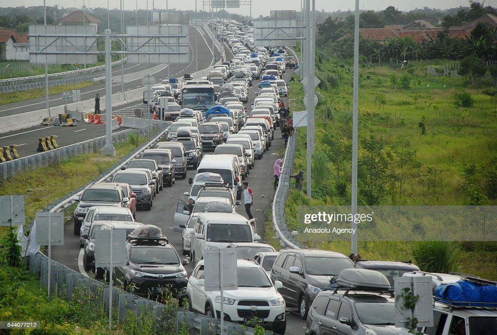 Muslim Indonesians return their homes to celebrate Eid al-Fitr as Thousands of cars wait due to Heavy traffic at Highway in Pejagan, Brebes, Central Java, Indonesia on July 1, 2016.