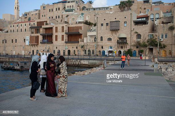 Muslim Israeli women walk in the port on the first day of Eid alFitr on July 28 2014 in Jaffa Israel As Israel's operation 'Protective Edge' in Gaza...