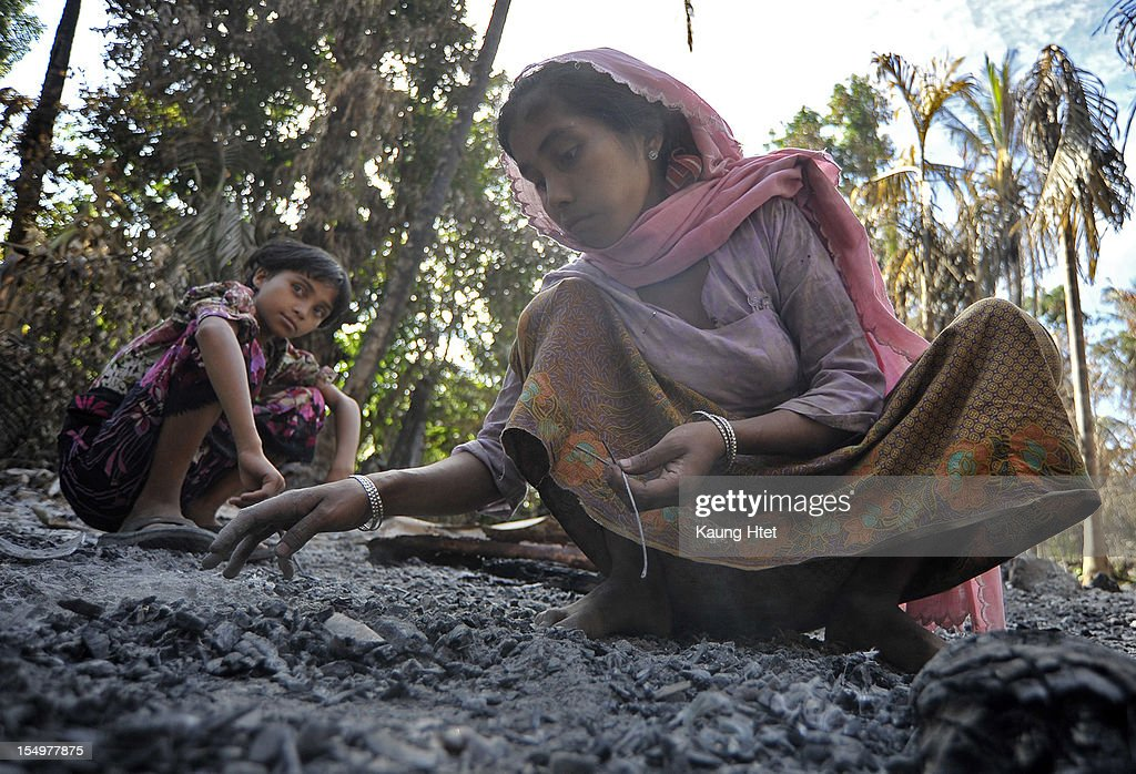 Muslim ladies collect metal pieces from the rubble of Muslim quarter in Pa Rein village, Myauk Oo township, that was burned in recent violence between Buddhist Rakhines and Muslim Rohingyas on October 29, 2012 in Rakhine state, Myanmar. Over twenty thousand people have been left displaced following violent clashes which has so far claimed a reported 80 lives. Clashes between Rakhine people, who make up the majority of the state's population, and Muslims from the state of Rohingya began in June.