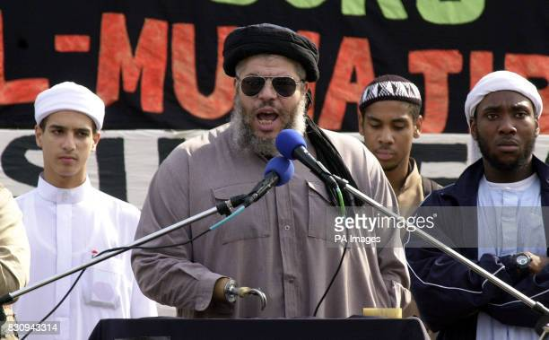 Muslim leader Sheikh Abu Hamza speaks to members of the Muslim group AlMuhajiroun during their rally in London's Trafalgar Square