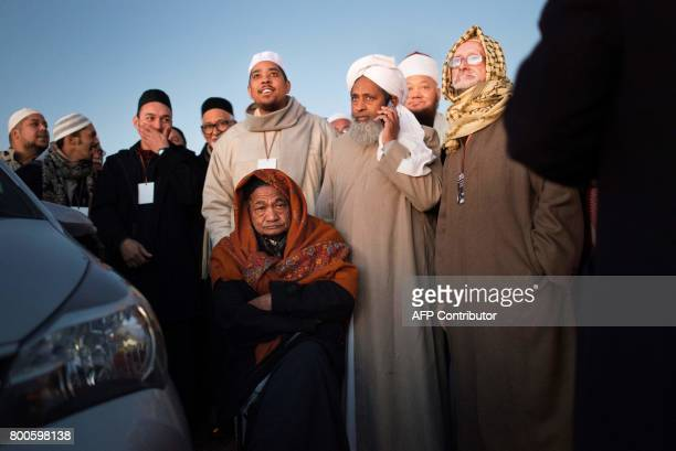Muslim leaders speak after the evening prayer at Three Anchor Bay in Cape Town on June 24 as they attempt to sight the new moon which would herald...