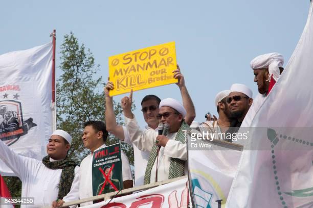 Muslim leaders speak to thousands of members of various Indonesian muslim groups demonstrate in support of Myanmar's Rohingya population in front of...