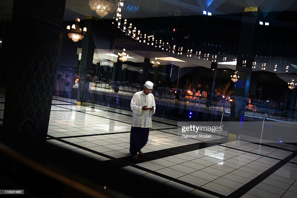 A Muslim man arrives at a mosque to perform the night prayer known as Tarawikh as millions of Muslims usher the beginning of Ramadhan on July 16, 2013 in Kuala Lumpur, Malaysia. During Ramadhan, Muslims refrain from consuming food, drinking liquids, smoking, swearing, and engaging in sexual relations from dawn till sunset.