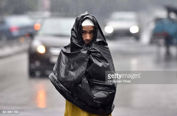 Muslim man going to offer prayer amid heavy rain on the occasion of Eid alAdha the festival of sacrifice at MasjideKhadira on September 2 2017 in...