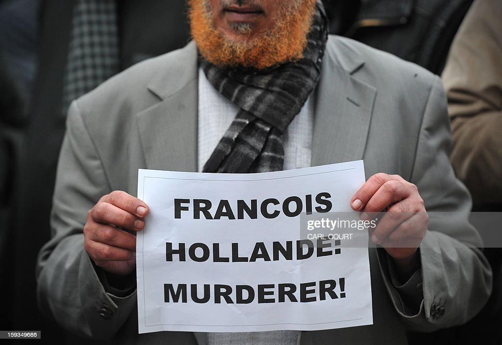 A Muslim man holds up a sign reading 'Francois Hollande: Murderer' as he joins a protest in response to French military action in Mali outside the French embassy in central London on January 12, 2013. Around 50 Muslim protesters shouted slogans and waved signs as they demonstrated outside the French embassy against French intervention in Mali. France sent troops on January 11 to help Malian forces hold back a rebel advance towards the capital Bamako, and on January 12 Paris announced that a French military pilot had been killed.