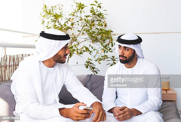 Muslim Man Listening to His Friend's Ideas in Lounge Area