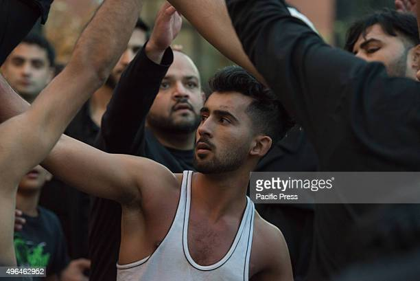 Muslim man participating in the procession performs matam a ritual pounding of the chest to signify mourning Shia Muslims gathered in Jersey City to...