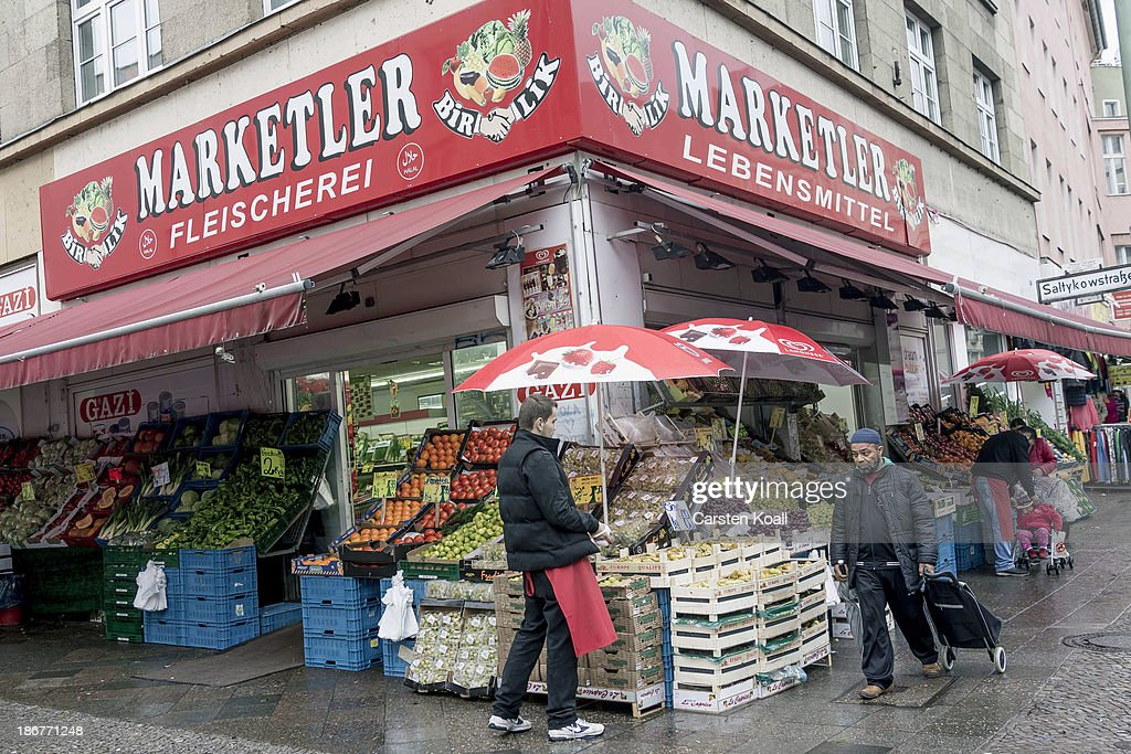 A muslim man passes the turkish supermarket Marketler at Karl-Marx-Strasse in Neukoelln district on November 02, 2013 in Berlin, Germany. According to recently published statistics, 7.2 million foreigners were living in Germany by the end of 2012, which is the highest number ever recorded. Of those 80% are from countries in the European Union, while the rest come primarily from Turkey, Russia, the former Soviet states and Arab countries.