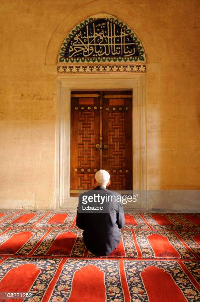 A Muslim man praying in a mosque