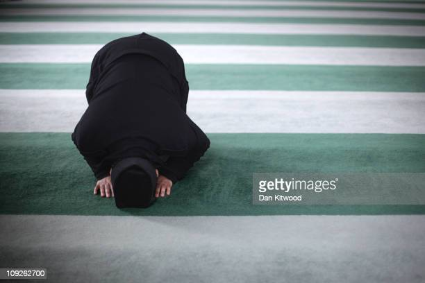 Muslim man prays at Baitul Futuh Mosque in Morden on February 18 2011 in London England Around five thousand Muslim men and women converged at the...