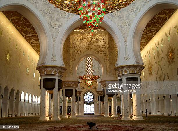 A Muslim man prays at the Sheikh Zayed mosque the third largest mosque in the world in Abu Dhabi on April 7 2009 The mosque is named after Sheikh...