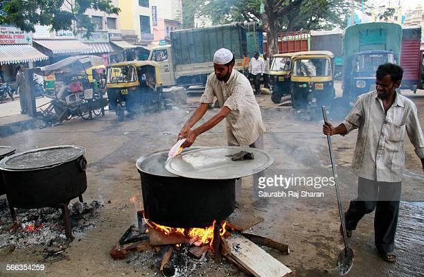 A Muslim man preparing Biriyani for evening feast Iftar during Ramadan 2013