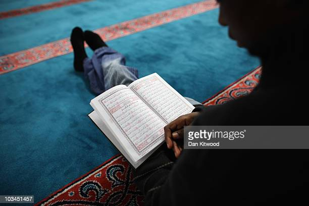 Muslim man reads the Koran before Iftar the evening meal in the Muslim holy month of Ramadan at the London Muslim Centre on August 18 2010 in London...