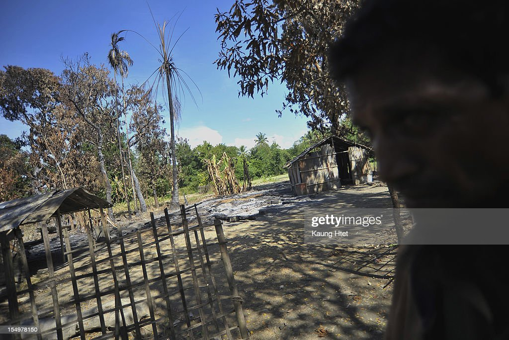 A Muslim man walks past a burned house in Muslim quarter of Pa Rein village in Myauk Oo township, that was burned in recent violence between Buddhist Rakhines and Muslim Rohingyas on October 29, 2012 in Rakhine state, Myanmar. Over twenty thousand people have been left displaced following violent clashes which has so far claimed a reported 80 lives. Clashes between Rakhine people, who make up the majority of the state's population, and Muslims from the state of Rohingya began in June.