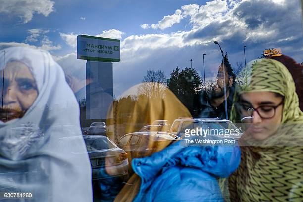 Muslim men and women attend Jumu'ah a congregational prayer held on Fridays at the Greater Gainesville Wyndham Hotel on Friday December 30 2016 in...