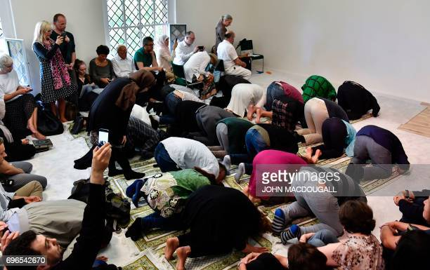 Muslim men and women pray together during an inaugural friday payer at the Ibn RushdGoethemosque in Berlin on June 16 2017 Founded by Seyran Ates the...
