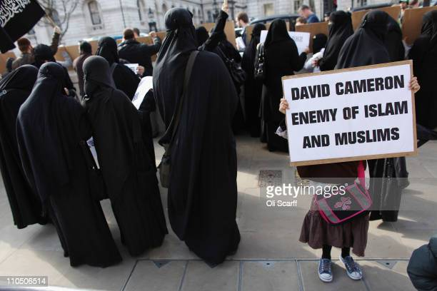 Muslim men and women protest opposite Downing street against the military action taken by the UK USA and France against Libya on March 21 2011 in...