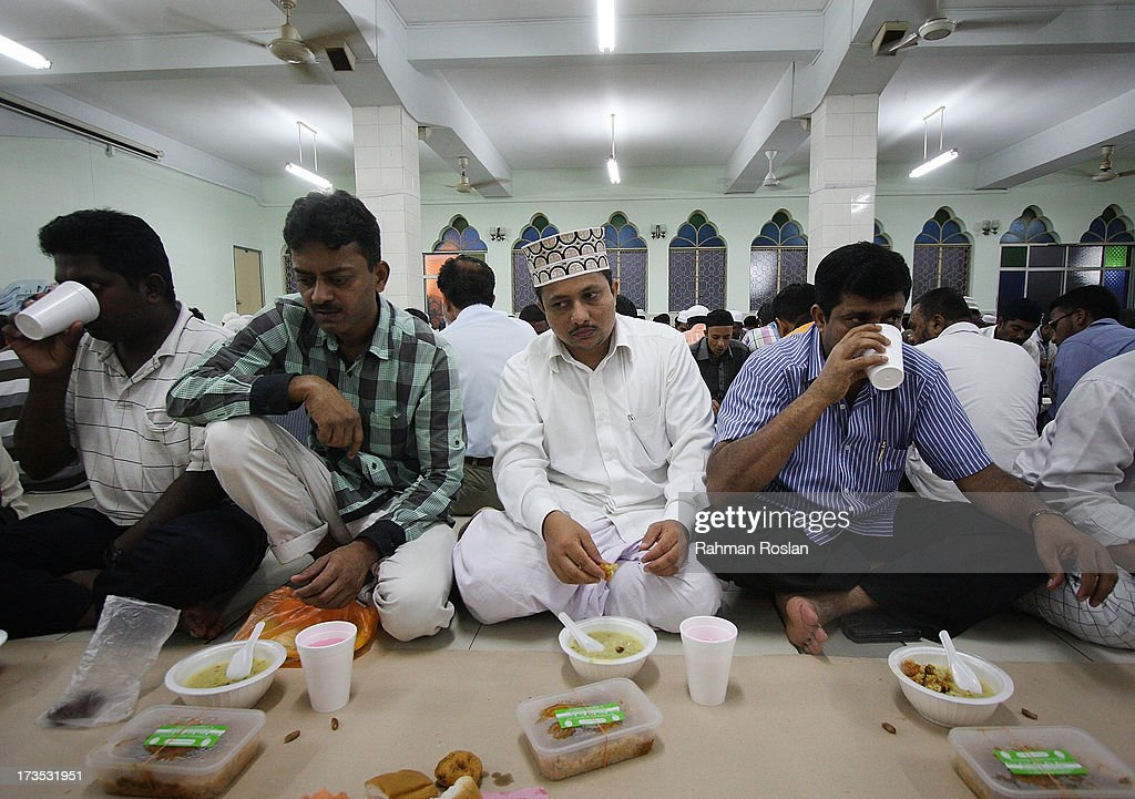 Muslim men breaks their fast as millions of Muslims observe the holiday of Ramadhan on July 16, 2013 in Kuala Lumpur, Malaysia. During Ramadhan, Muslims refrain from consuming food, drinking liquids, smoking, swearing, and engaging in sexual relations from dawn till sunset.