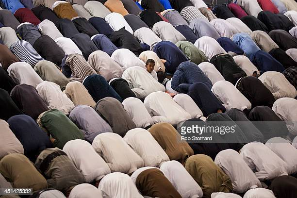 Muslim men conduct Tarawih prayers during which long portions of the Qur'an are recited at the East London Mosque on the evening before the start of...