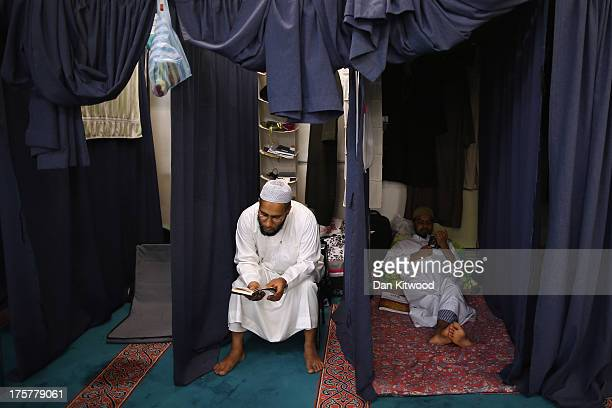 Muslim men gather around their private cubicles at the East London Mosque on August 7 2013 in London England For the last ten days of Ramadan some...