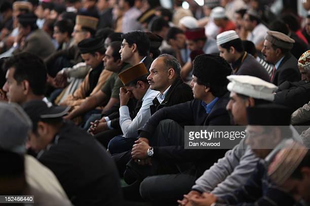 Muslim men listen to a speach by the Islamic Khalifa of the Ahmadiyya Muslim community Mirza Masroor Ahmad at Baitul Futuh Mosque in Morden on...