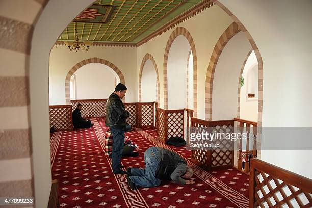 Muslim men mostly Crimean Tatars arrive for Friday midday prayers at the KebirDzhami Mosque which is the city's oldest on March 7 2014 in Simferopol...