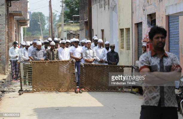 Muslim men offer Friday namaj as city returns to calm amidst tight security on September 13 2013 in Muzaffarnagar India Administration today eased...