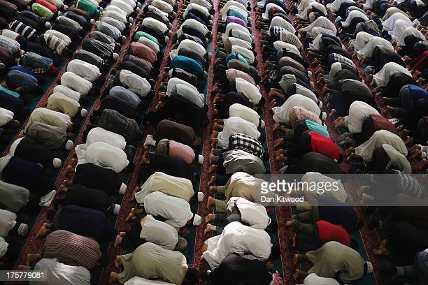 Muslim men pray at the East London Mosque on the last day of Ramadan on August 7 2013 in London England The holy month of Ramadan ended last night...