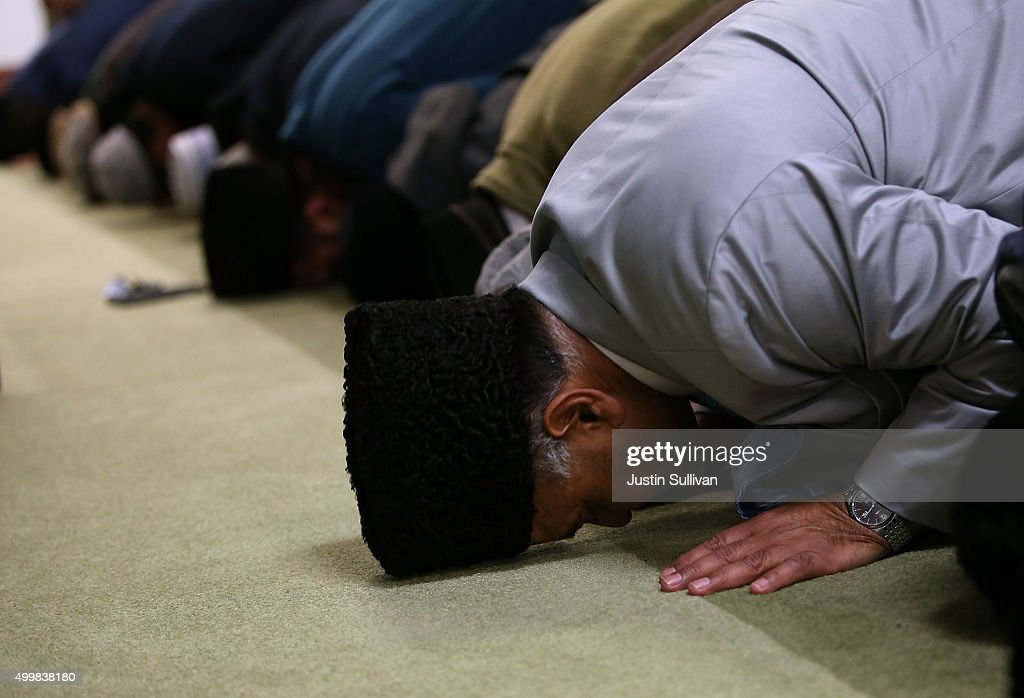 Muslim men pray in the mosque during a prayer vigil at Baitul Hameed Mosque on December 3 2015 in Chino California The San Bernardino community is...