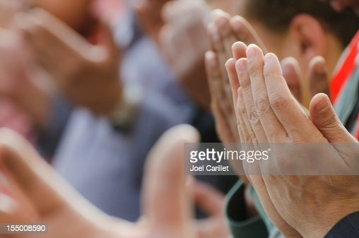 Muslim men praying with lifted hands in Cairo, Egypt