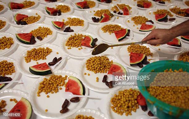Muslim men serve food for Iftar the evening meal during the Muslim holy month of Ramadan at the London Muslim Centre on August 18 2010 in London...