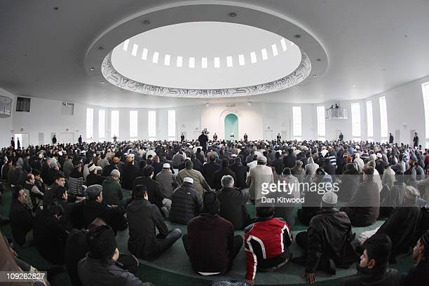 Muslim men wait to pray at Baitul Futuh Mosque in Morden on February 18 2011 in London England Around five thousand Muslim men and women converged at...