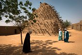 Muslim men walk near the Askia mosque on February 27 2013 in Gao Chad's President Idriss Deby Itno on Wednesday urged the Malian army and West...